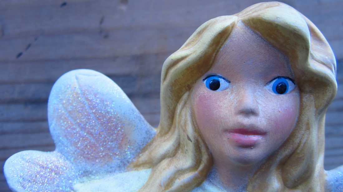 Ceramic Painted Laying Down Fairy